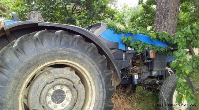 Traktör ile ağaç arasında kalarak can verdi