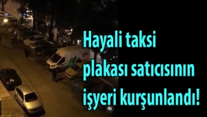 İzmir'de hayali taksi plakası sattığı iddia edilen kişilerin işyeri kurşunlandı!