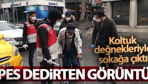 İstanbul'da koltuk değnekleriyle dışarıya çıkan yaşlı adam 'pes' dedirtti